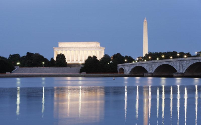 Monuments and Potomac River at night